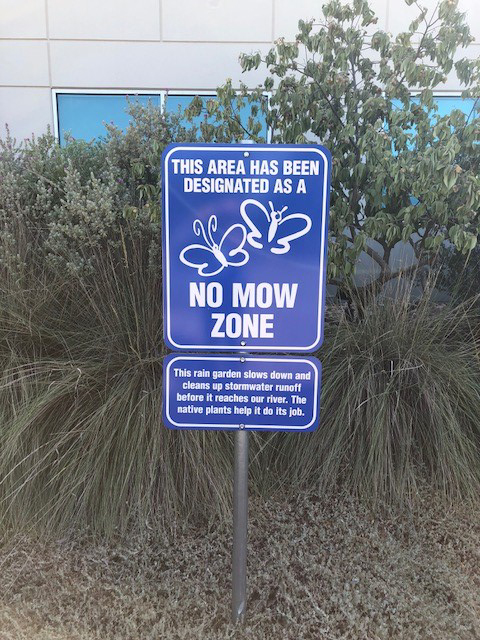 No mow zone sign indicating a rain garden that slows down storm water runoff.