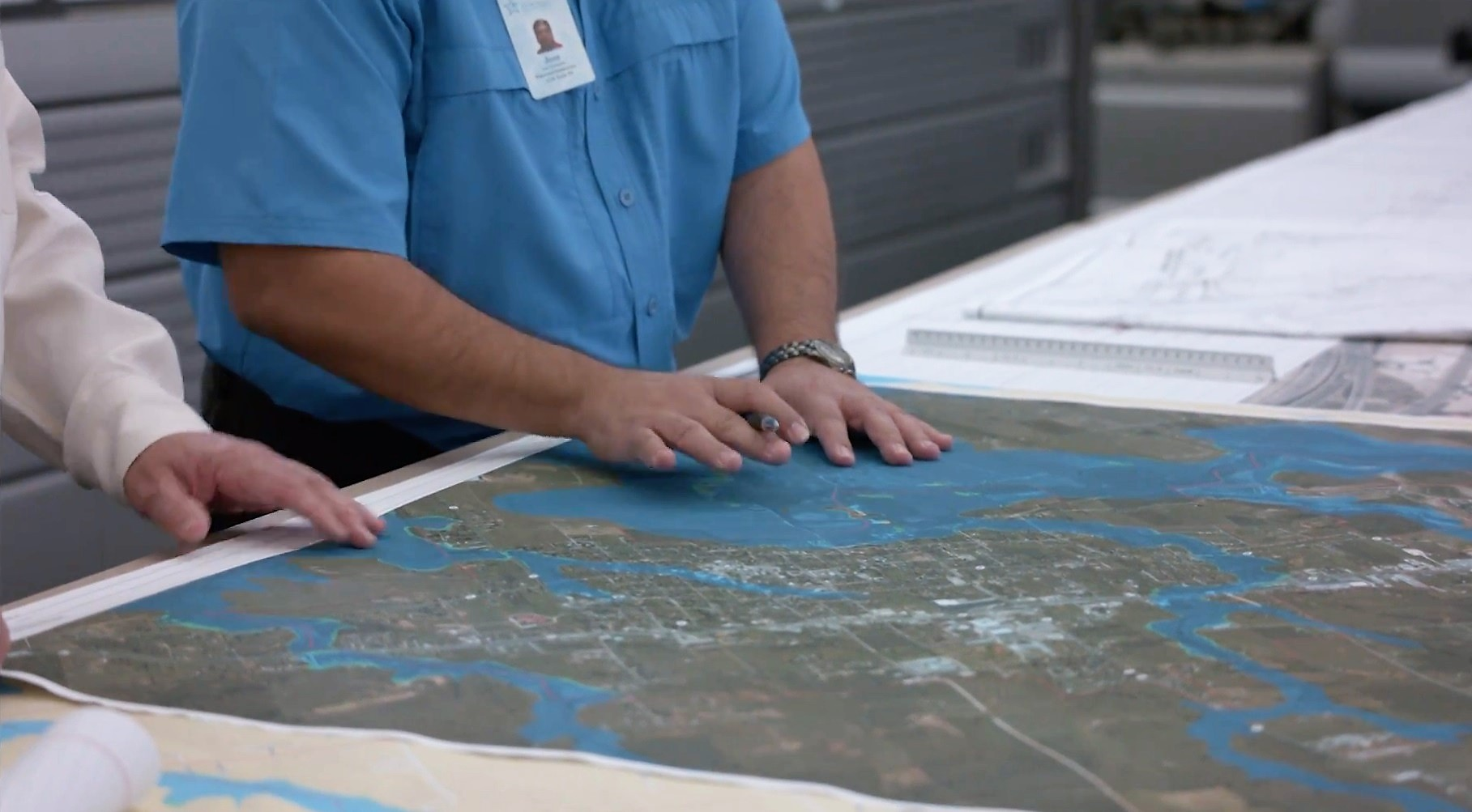 Picture of Scientists working with maps and data to mitigate flooding.