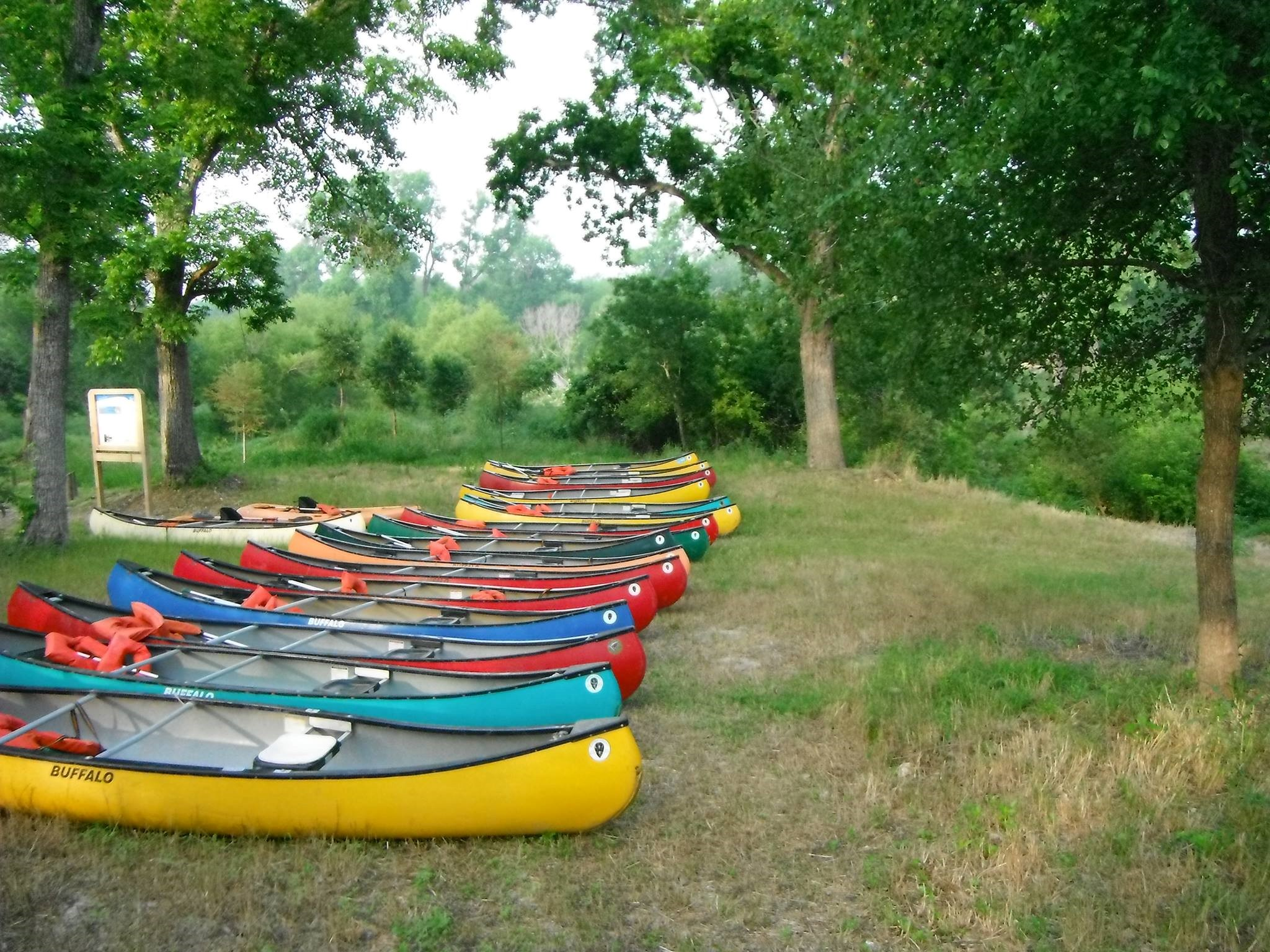 Canoes line up along the SASPAMCO Paddling Trail take out point at Helton Nature Park