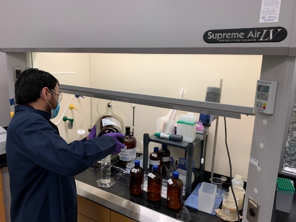 Benjamin Guerra (PT Water Quality Scientist) preparing solutions for chlorophyll/pheophytin analysis in support of the Clean Rivers Program.