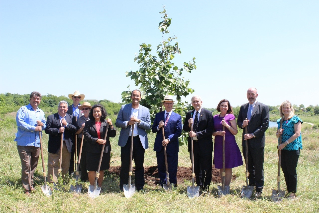 Celebrating with project partners the last tree planting of the Mission Reach Ecosystem Restoration & Recreation Project