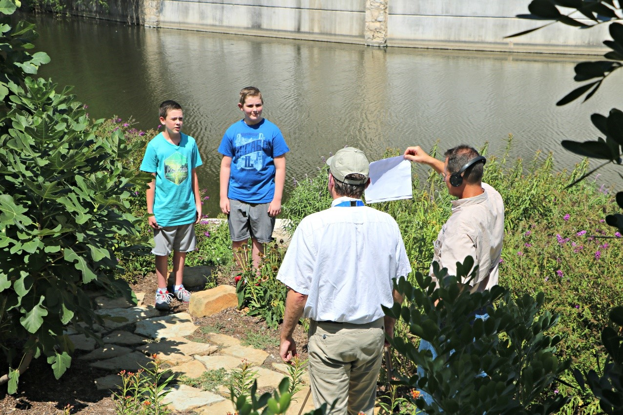 River Authority's Director of Human Resources kids participating in a stormwater runoff PSA in 2017