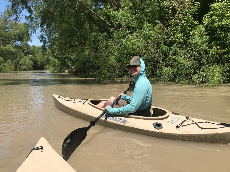 My youngest son Jared, who is a wildlife biologist studying mussels, kayaking on the San Antonio River near our home in Goliad.