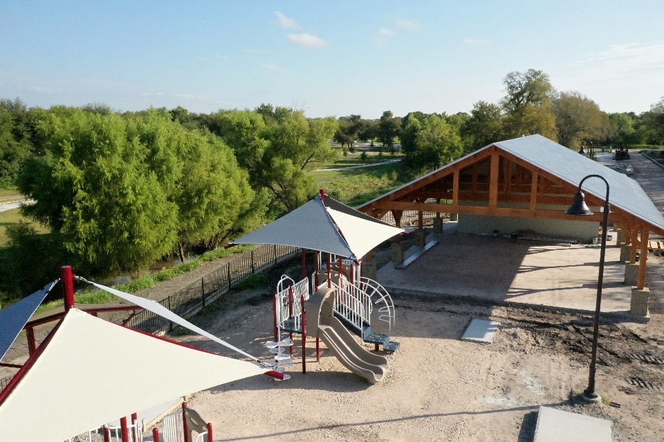 Overview of Escondido Creek Parkway playground and pavilion.