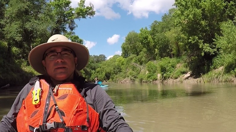 River Authority Director of External Communications Steven Schauer kayaking the San Antonio River in Goliad County.