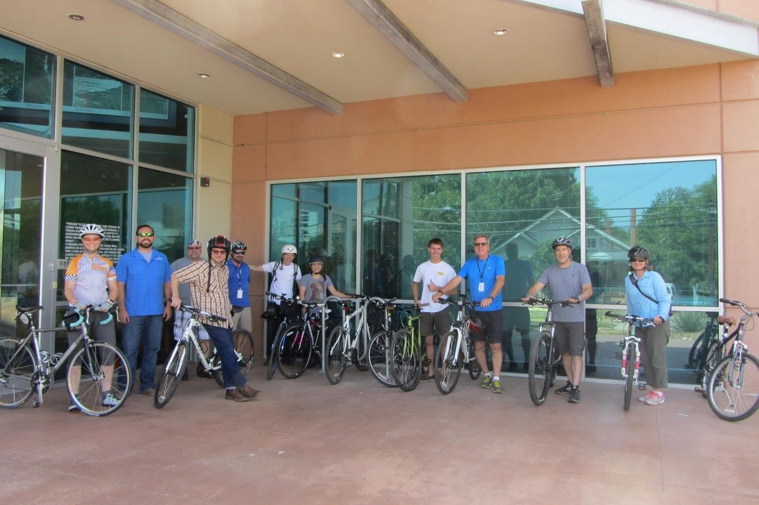 San Antonio River Authority staff pose in front of the installed bike racks at our Euclid office