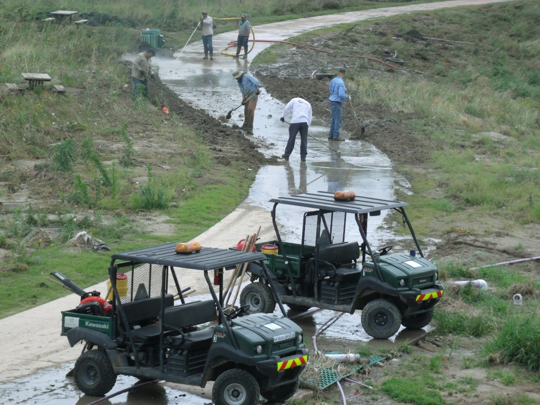 River Authority Watershed & Park Operations staff work to remove silt and debris in the aftermath of the Memorial Day flood of 2013.