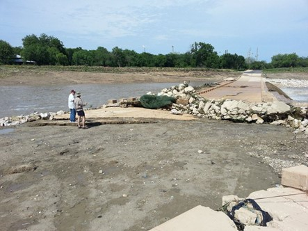 River Authority staff inspect damage to the Mission Parkway low water crossing following the Memorial Day Weekend flood of 2013.