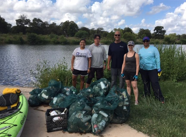 River Authority River Warrior volunteers participate in a post-storm event cleanup