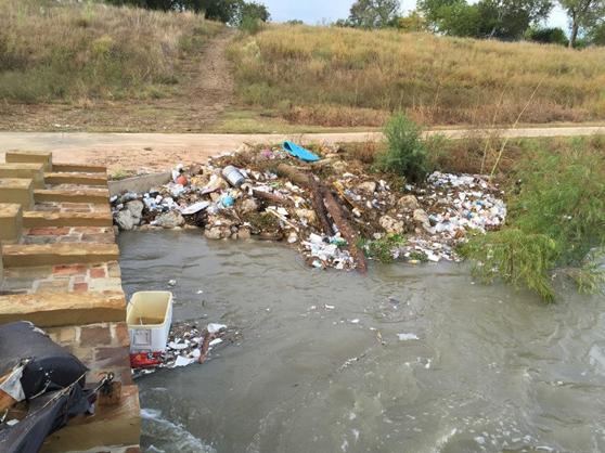 Trash on the San Antonio River Walk Mission Reach following a rain event.