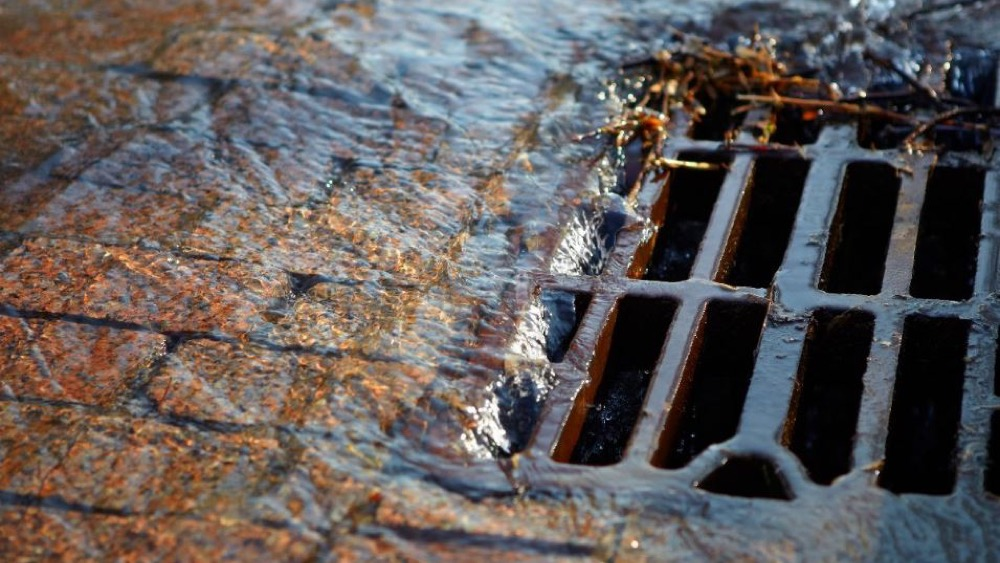 Stormwater going down a street drain