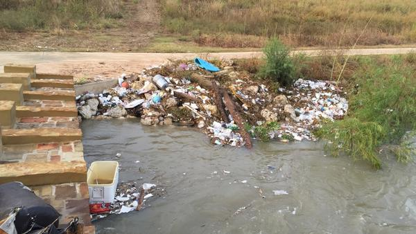 Trash and debris in the San Antonio River
