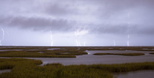 A storm and lightning over marshland