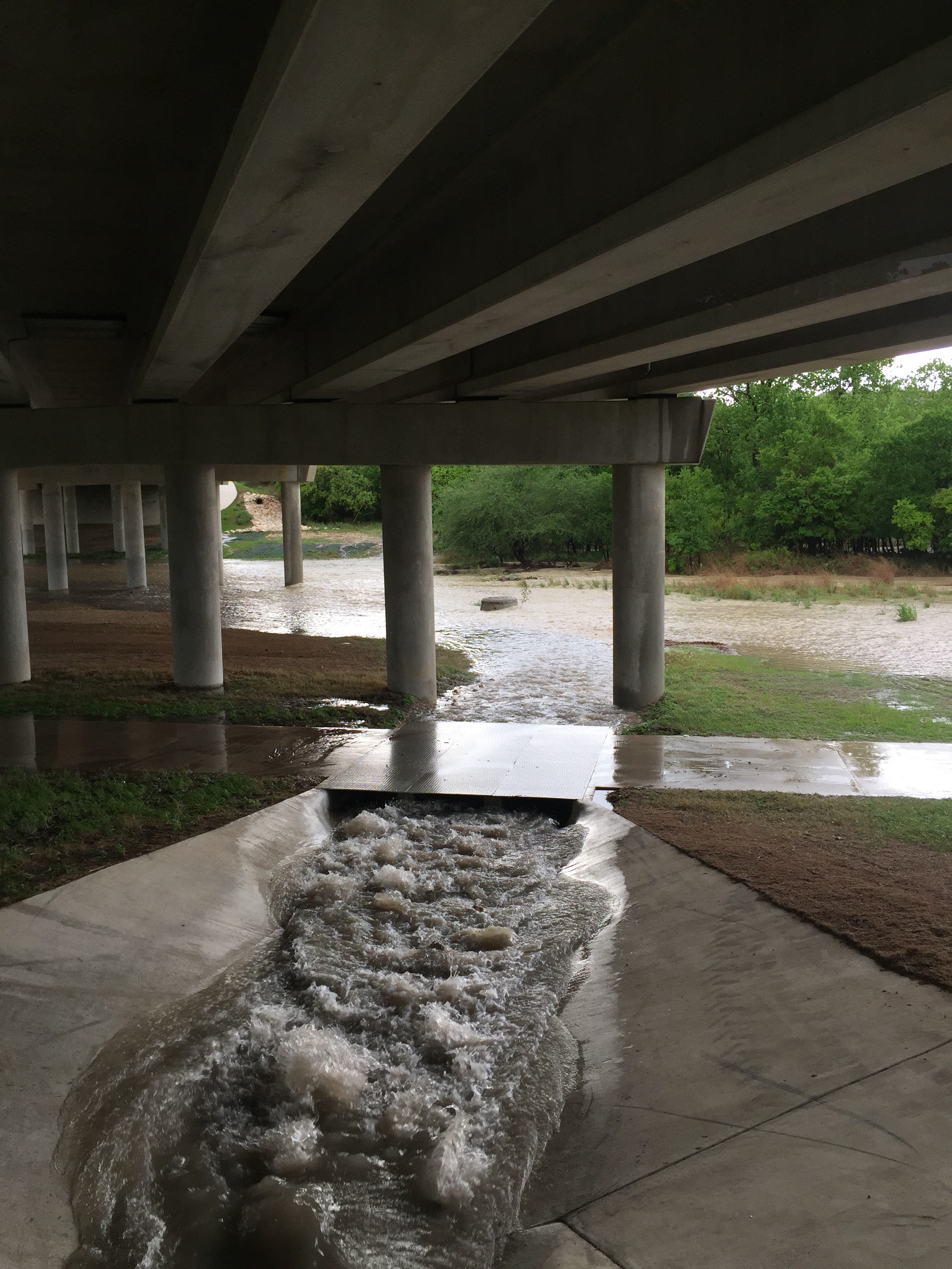 Water flowing under overpass