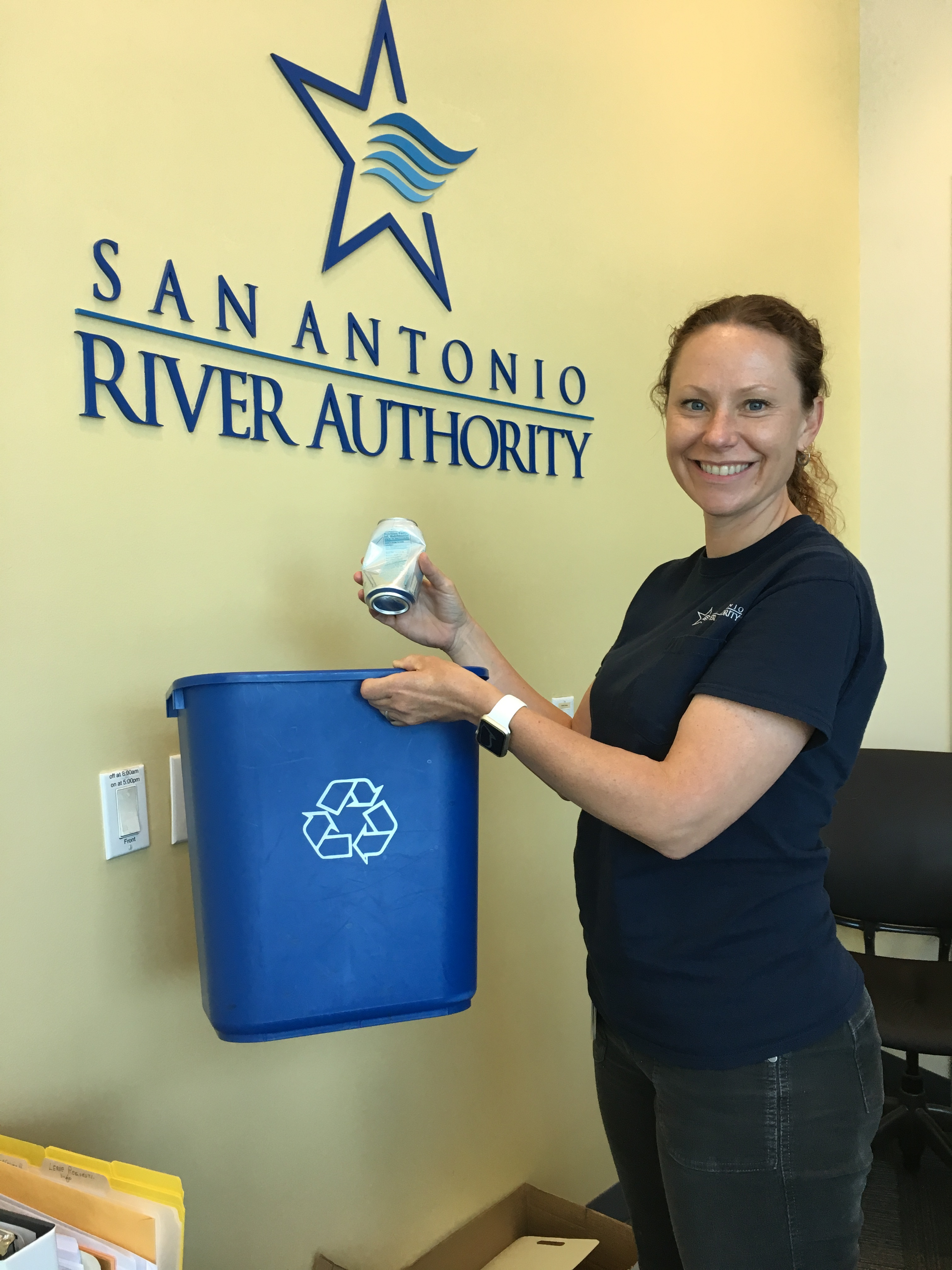 Woman recycling at San Antonio River Authority