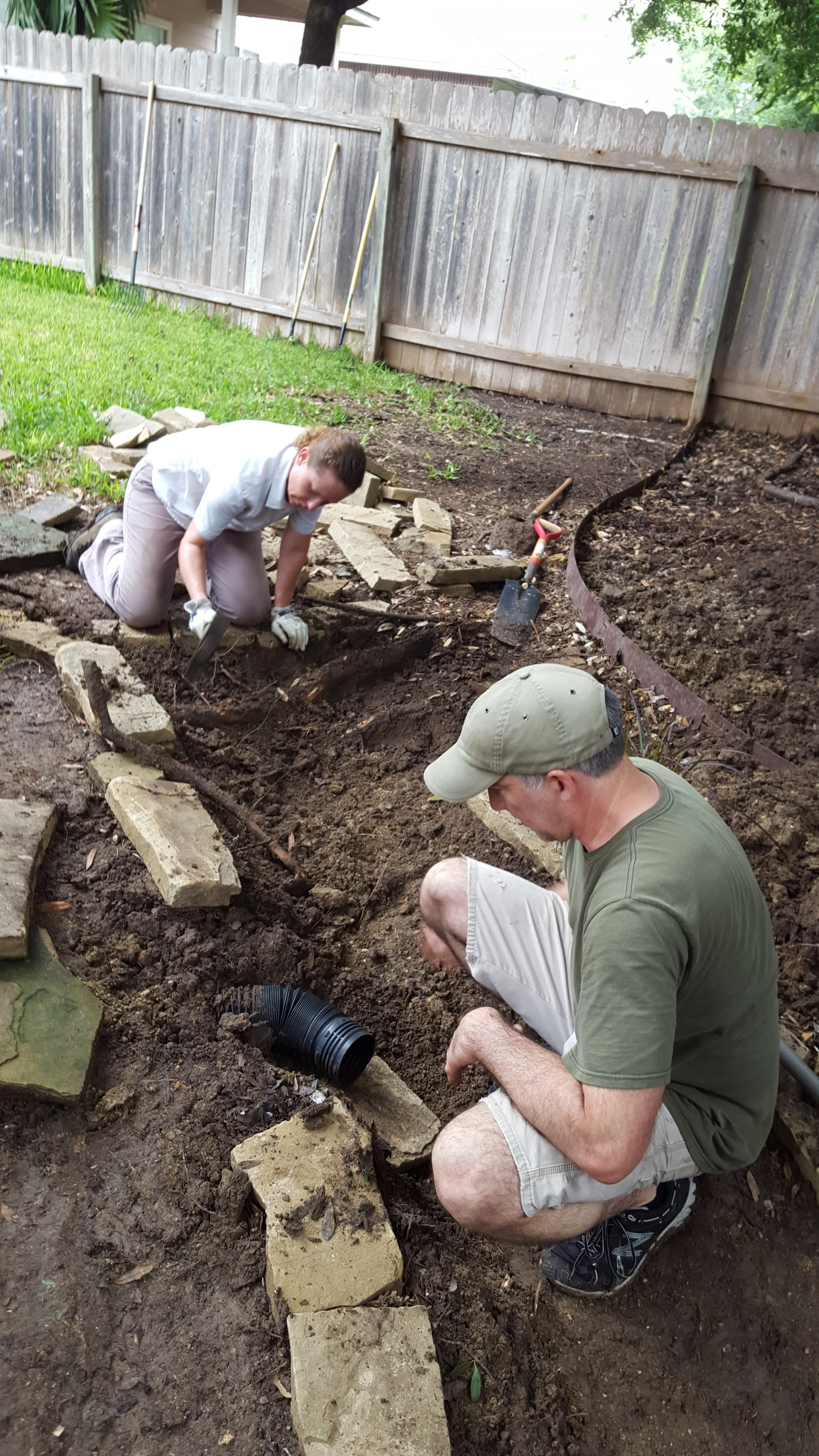Man and woman planting in a garden