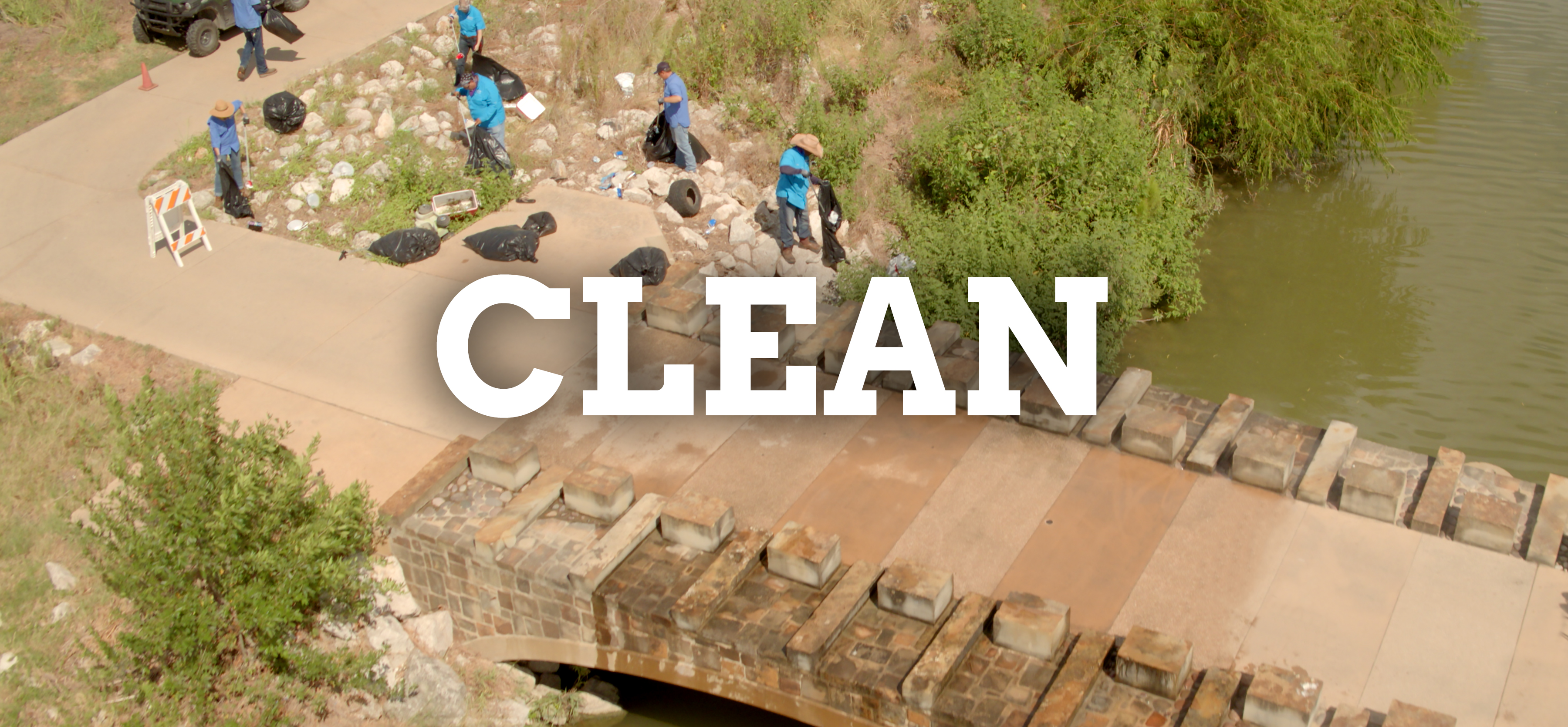 River Authority workers picking up trash along the Mission Reach