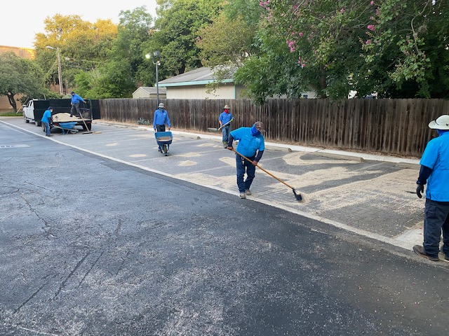 River Authority staff conducting permeable paver maintenance at our Guenther office