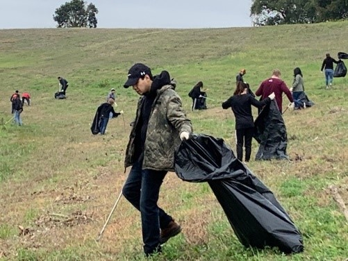 River Warrior volunteer participating in post storm event cleanup event
