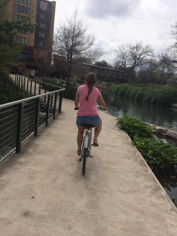 Graham Enjoying a bike ride along the Museum Reach San Antonio River Walk segment with his daughter.