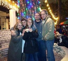 Stephen Graham enjoying the holiday lights in the downtown segment of the River Walk with his family.